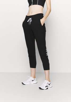 TRACK LOGO - Tracksuit bottoms - black