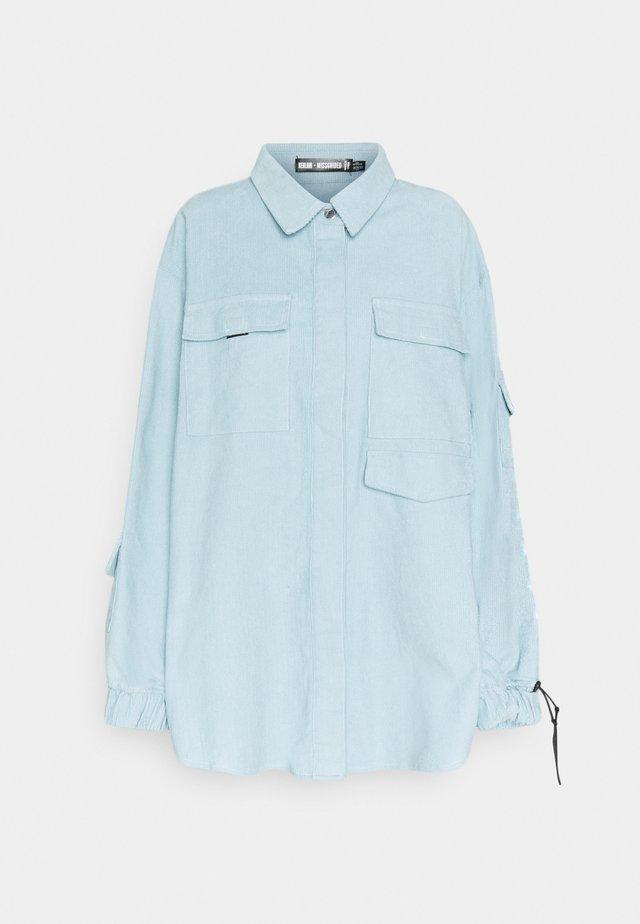 OVERSIZED UTILITY SHIRT - Button-down blouse - dusky blue