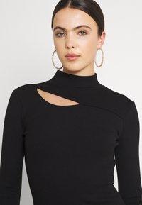 Forever New - CUT OUT DRESS - Žerzejové šaty - black - 3