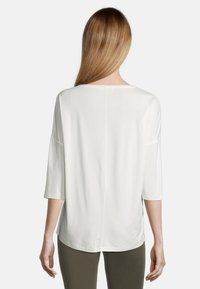 Cartoon - MIT AUFDRUCK - Long sleeved top - cream/nature - 2