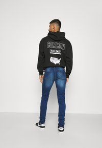 CLOSURE London - RIPPED SLIM FIT  - Slim fit jeans - blue - 2