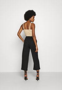 ONLY - ONLNAIRI CECILY WIDE PANT - Broek - black - 2
