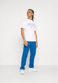 Hi-Tec - JARVIS PANTS - Trousers - blue - 1