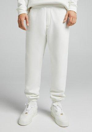 UNISEX - Tracksuit bottoms - white