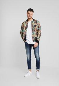 Redefined Rebel - STOCKHOLM TERRY - Slim fit jeans - dark sea - 1