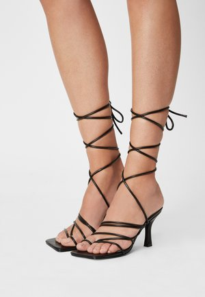 RIYA - Sandals - black