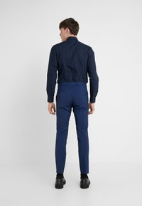 HUGO - GRIFFIN - Suit trousers - medium blue - 2
