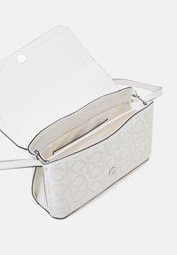 Calvin Klein - FLAP XBODY - Across body bag - white - 2