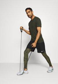 Nike Performance - Leggings - medium olive/white - 1