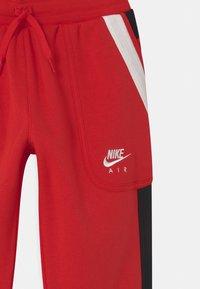 Nike Sportswear - AIR - Pantalones deportivos - university red/black/white - 2