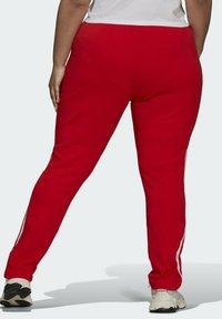 adidas Originals - PRIMEBLUE SST - Tracksuit bottoms - red - 1