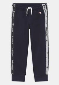 Champion - AMERICAN TAPE PANTS UNISEX - Teplákové kalhoty - dark blue - 0