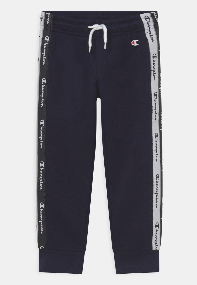 Champion - AMERICAN TAPE PANTS UNISEX - Teplákové kalhoty - dark blue