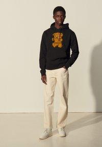 sandro - HOODIE TEDDY - Sweatshirt - noir - 0
