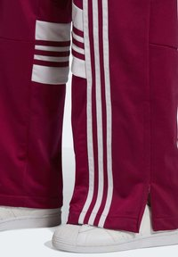 adidas Originals - DANIËLLE CATHARI JOGGERS - Joggebukse - purple - 7