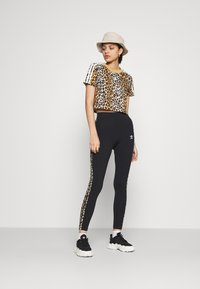 adidas Originals - TIGHT - Leggings - Trousers - black
