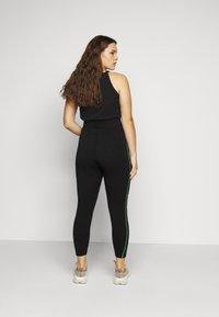 Nike Sportswear - Leggings - Trousers - black/poison green - 2