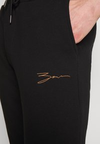 Zign - Tracksuit bottoms - black - 5