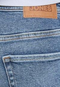 Jack & Jones Junior - Slim fit jeans - blue denim - 6