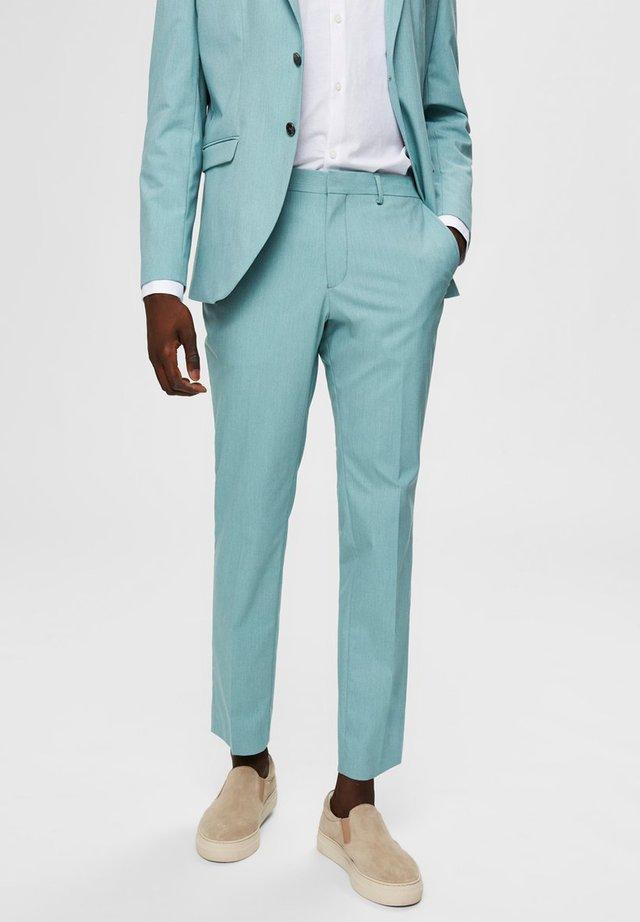 Spodnie garniturowe - green milieu