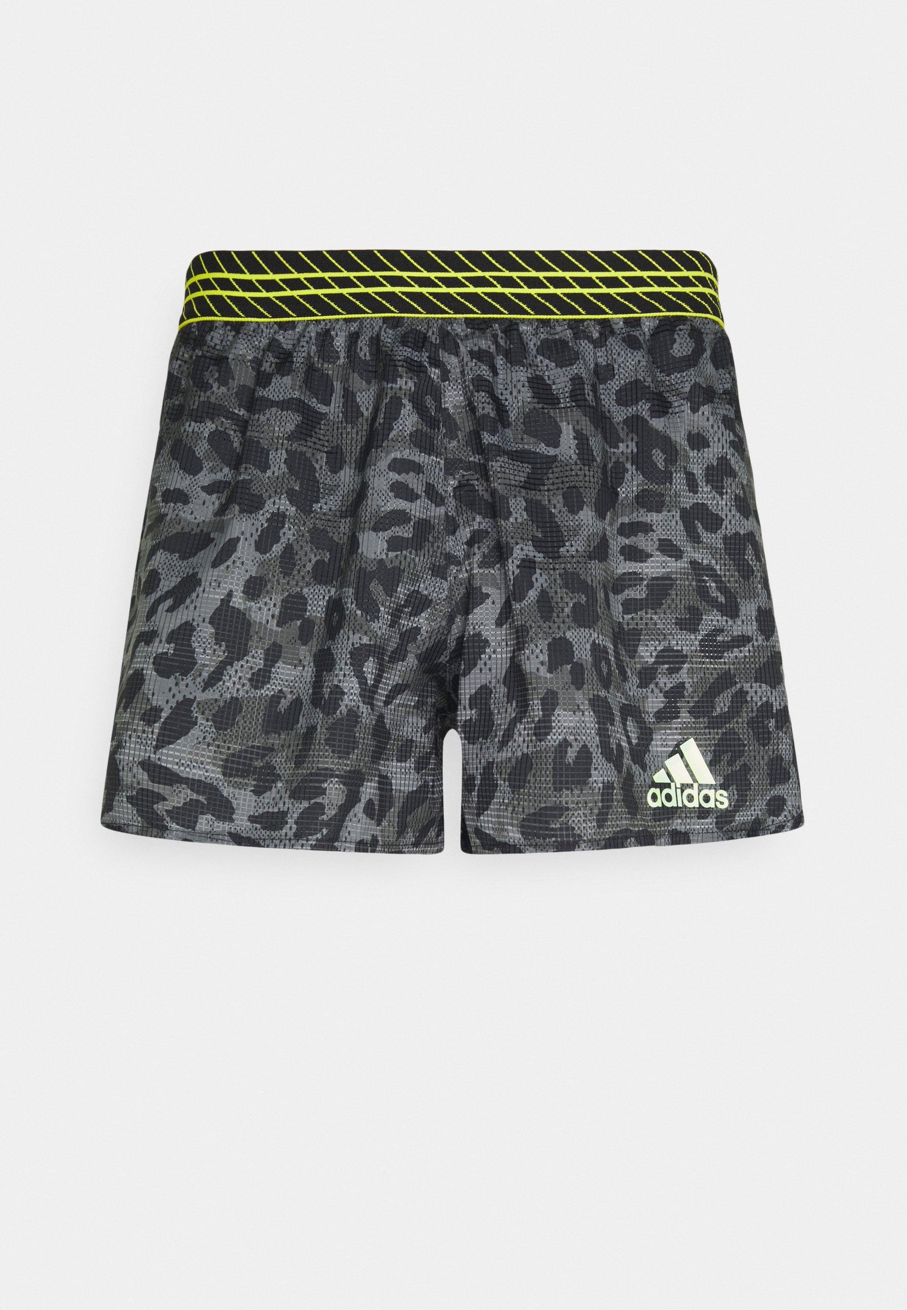 Men PROMO ADIZERO SPLIT PRIMEGREEN RUNNING SHORTS - Sports shorts