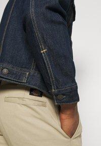 Levi's® - THE TRUCKER - Denim jacket - med indigo - 4