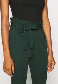 Vero Moda Tall - VMEVA PAPERBAG PANT - Trousers - pine grove - 4