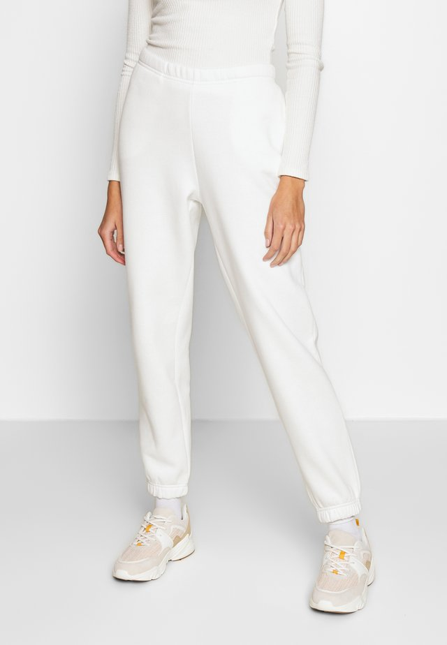 BASIC - Pantalon de survêtement - off white