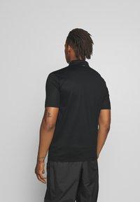 HUGO - DOLDEN - Polo shirt - black - 2