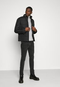 Calvin Klein - QUILTED JACKET - Light jacket - black - 1