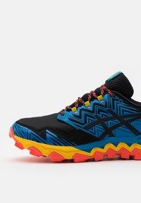 ASICS - GEL-FUJITRABUCO  - Trail running shoes - blau/orange - 5