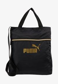 Puma - CORE SEASONAL SHOPPER - Tote bag - black/gold - 5