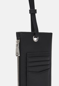Calvin Klein Jeans - PRIDE PHONE LANYARD UNISEX - Across body bag - black - 3
