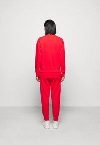 Polo Ralph Lauren - FEATHERWEIGHT - Tracksuit bottoms - bright hibiscus - 2