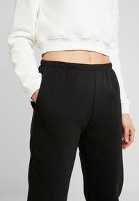 Nly by Nelly - COZY PANTS - Tracksuit bottoms - black - 4