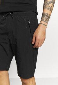 Calvin Klein - REGULAR FIT CRINKLE - Teplákové kalhoty - black - 3