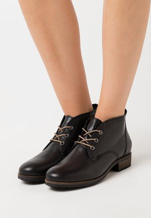 BRUNA - Ankle boots - black