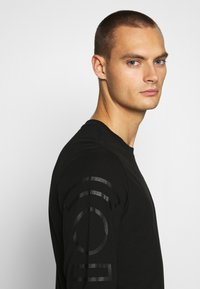 G-Star - LOGO GRAPHIC  - Long sleeved top - black - 4