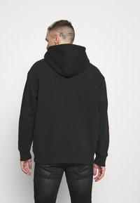 Levi's® - RELAXD GRAPHIC HOODIE UNISEX - Felpa con cappuccio - black - 2