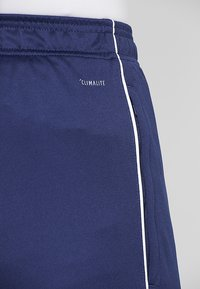 adidas Performance - CORE - Tracksuit bottoms - dark blue/white - 4