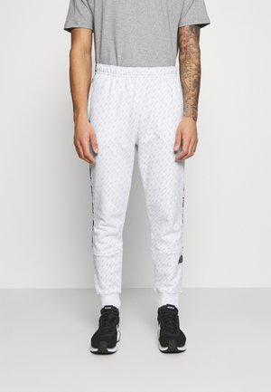 REPEAT PRINT - Pantalones deportivos - white/black