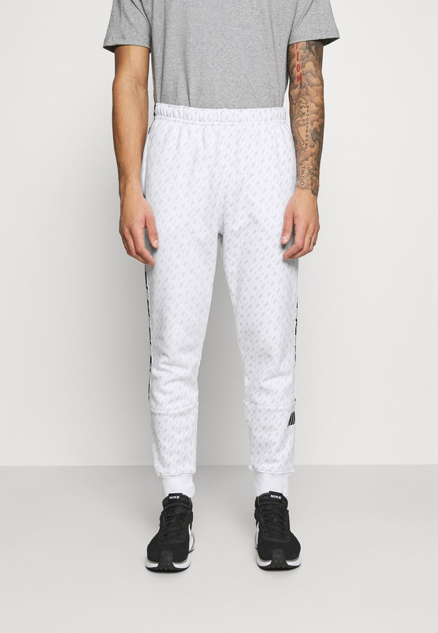 REPEAT PRINT - Pantaloni sportivi - white/black
