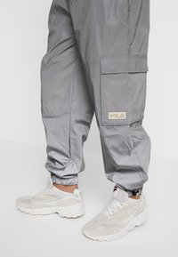 Fila - FILA FOR WEEKDAY MALEK REFLECTIVE TRACKPANTS - Tracksuit bottoms - silver reflective - 6