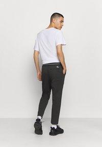 Calvin Klein Jeans - Tracksuit bottoms - mottled black - 2