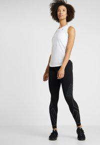 Puma - IGNITE TANK - Sports shirt - white