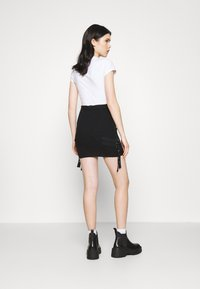 The Ragged Priest - SKIRT BUCKLE STRAP DETAIL - Mini skirt - black
