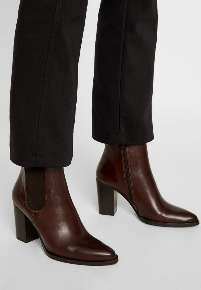 High heeled ankle boots - darkbrown