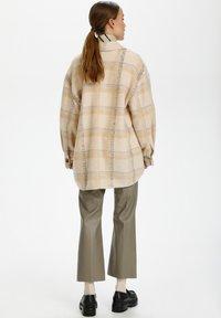Soaked in Luxury - Short coat - sandshell check - 2