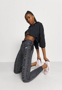 Nike Performance - AIR JACKET CROP - Outdoor jacket - black/reflective silver - 1