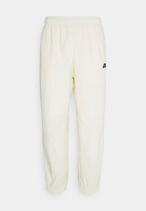 NOVELTY TRACK PANT UNISEX - Tracksuit bottoms - coconut milk/black